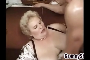 Chunky plus breasty granny enjoying a ding-dong