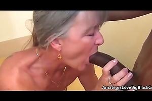 Aged haired granny enjoys detailed gloomy penis