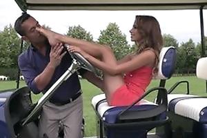 Cute lady does footjob on golf field till cum