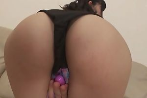 Asian damsel plays with her hairy pussy on be passed on couch