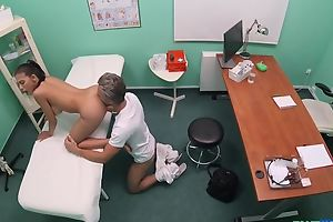 Brown-eyed beauty gets fingered and fucked by horny doctor